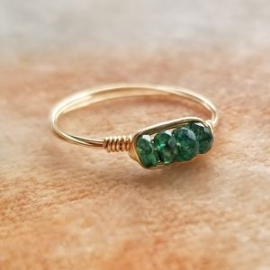 Anthropologie gold wire ring with emeralds
